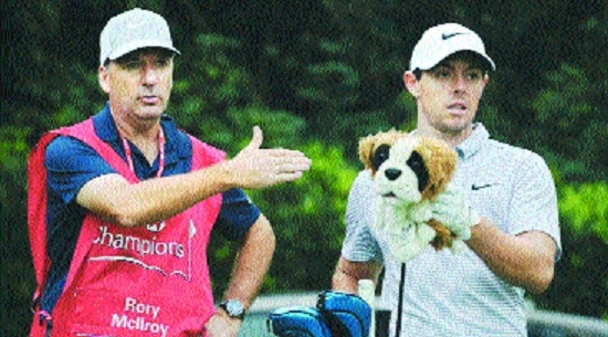 McIlroy fires long-time caddie
