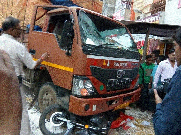12 hurt as mini-truck rams into shop