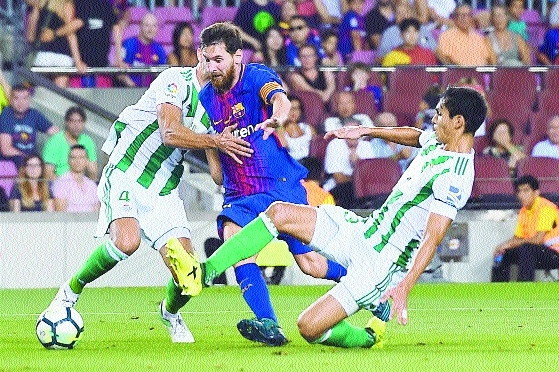 Barca honour terror attack victims in Betis win