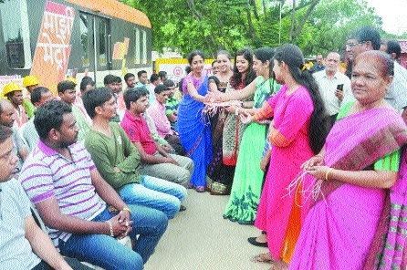 Laudable gesture: Women tie rakhis to Metro Rail workers
