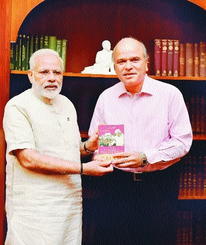 P M N Modi receives a book on A P J Abdul Kalam written S M Khan.jpg