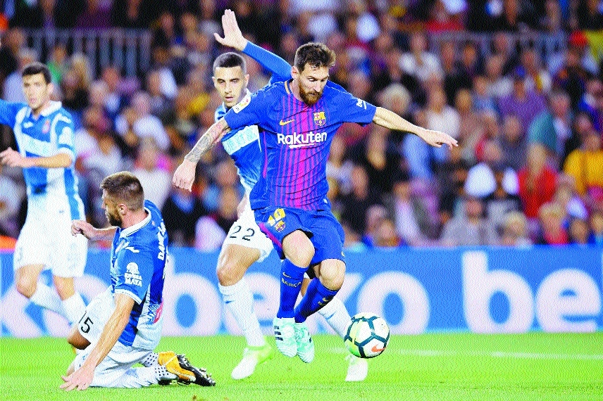Messi 'tricks; Barca, Sociedad top the ladder
