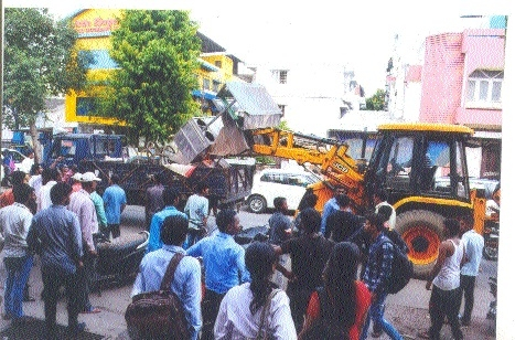 Structures mushrooming on roads removed during encroachment drive