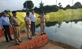Collector, officials inspect preliminary preparations at artificial ponds