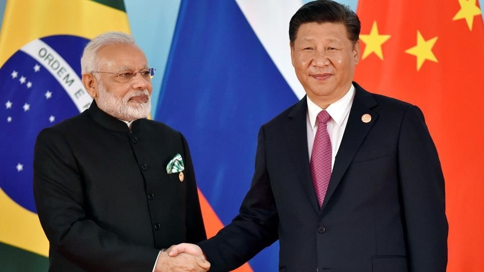 Xi, Modi display bonhomie during BRICS Summit