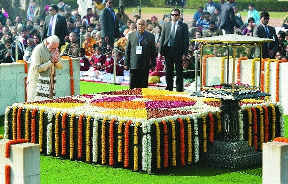 P M Narendra Modi pays tribute at Mahatma Gandhis memorial on his death anniversary at Raj Ghat