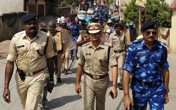 Raipur police take out flag march