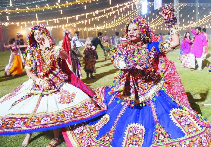 Folk dancers perform on the occasion of Navratri at Adani Shantigram Township Ahmedabad
