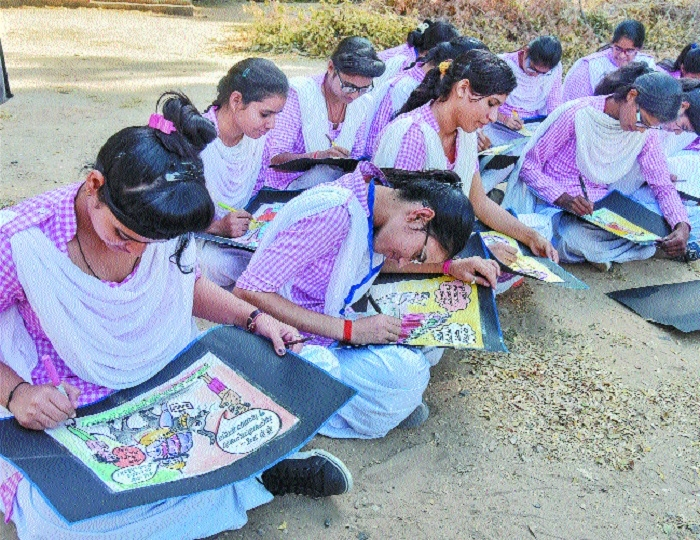 Students participate making political posters during an election awareness campaign in Bikaner