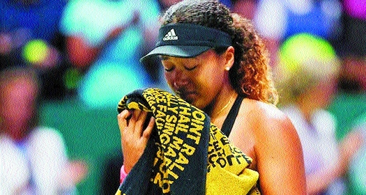 Osaka to focus on form after tearful end