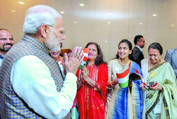 P M Narendra Modi being welcomed by Indian community Airport to attend the India Japan Annual Summit