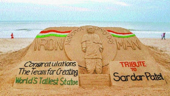 Sand sculptor Sudarshan Pattnaik creates a sand art on the birthday eve of Indias first Deputy PM Sardar Vallabhbhai Patel in Puri
