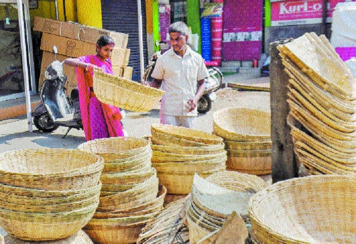 People buy bamboo baskets used during Chhath Puja festival in Guwahati on Saturday