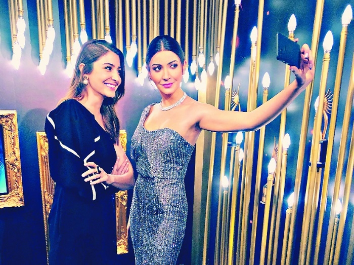 Anushka Sharma L reacts as she looks at her unveiled interactive wax statue at Madame Tussauds in Singapore