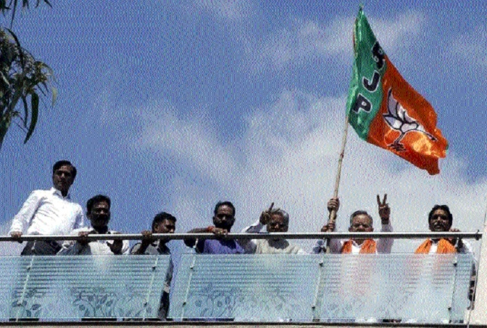 Party workers hoist BJP flag at their residences