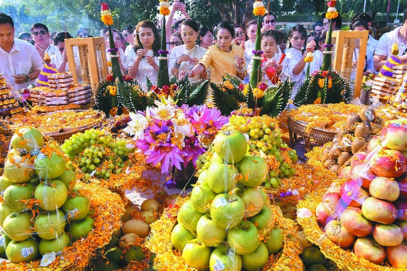 Buddhist devotees take part in Dev Puja at Mahabodhi Temple during Kathina Robe offer ceremony in Bodh Gaya Bihar on Sunday