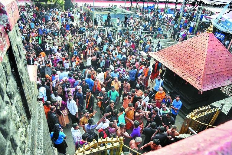 Sabarimala protesters target women, police book 200