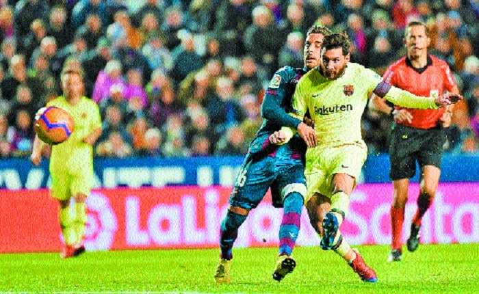 Messi hat-trick puts Barcelona on top