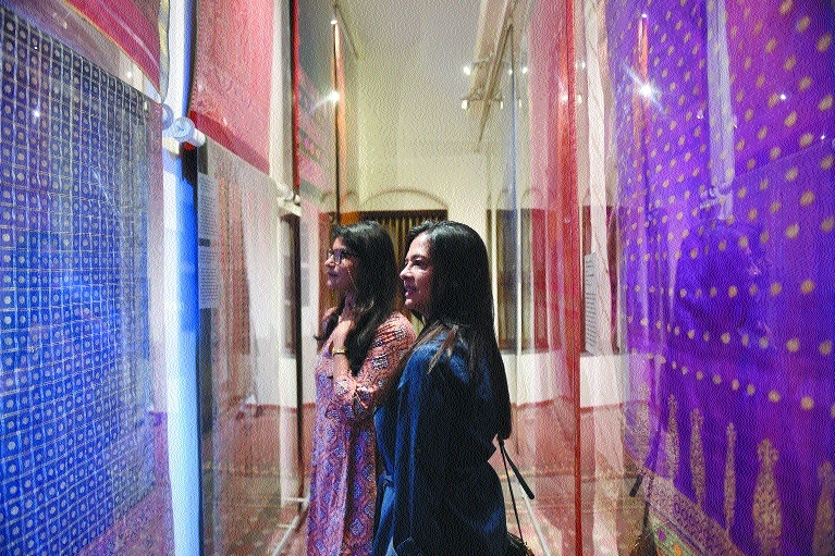Women visit a gallery of sarees and shawls at the House of MG mansion in Ahmedabad
