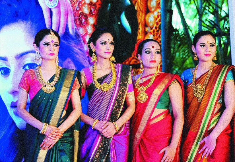 Models showcase jewellery designs during a press conference during Jewels of India exhibition in Bengaluru on Thursda
