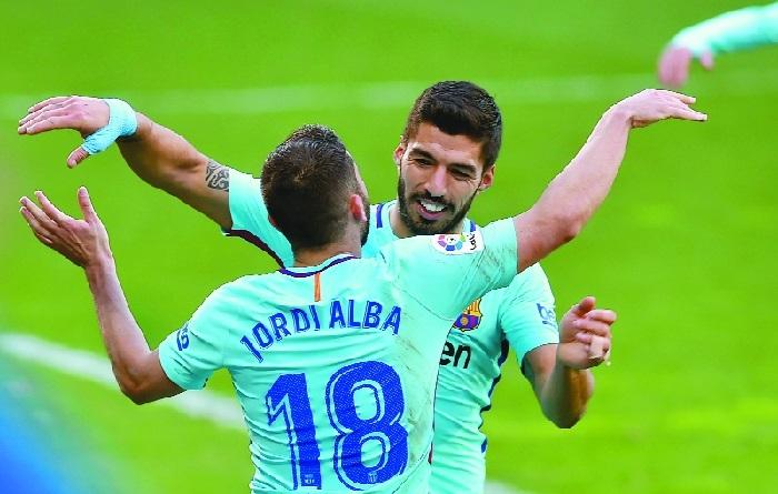 Suarez, Alba fire Barca to victory