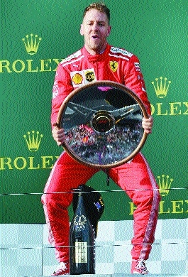 Vettel steals victory from Hamilton