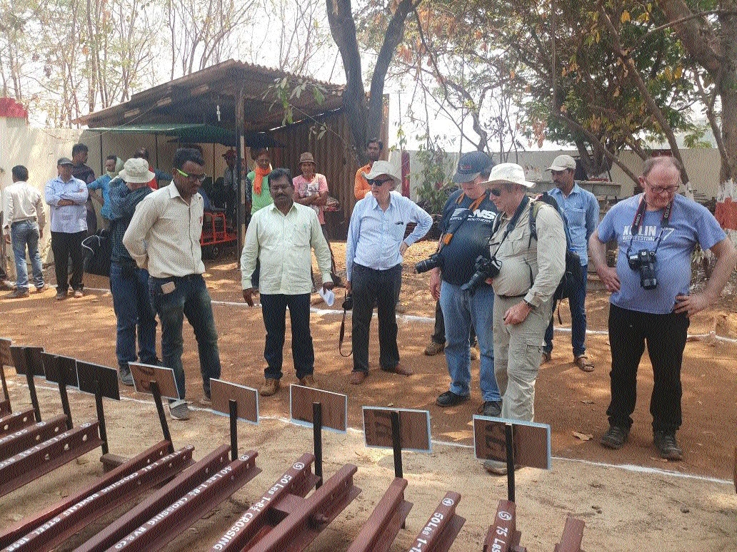 Tourists study narrow gauge railway system