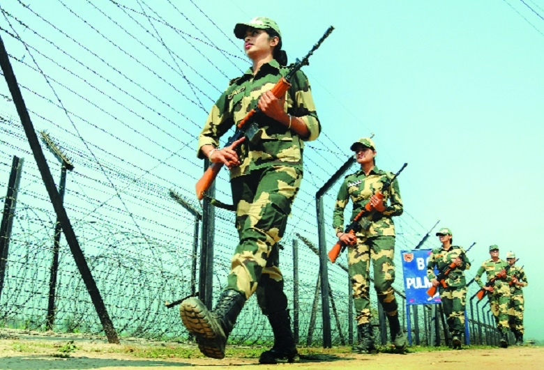 Border Security Forces women soldiers patrol near the barbed fence IndoPakistan border Amritsar on Womens Day