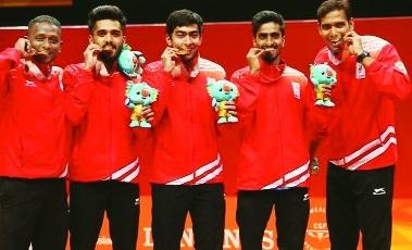 Men join table, clinch team TT gold