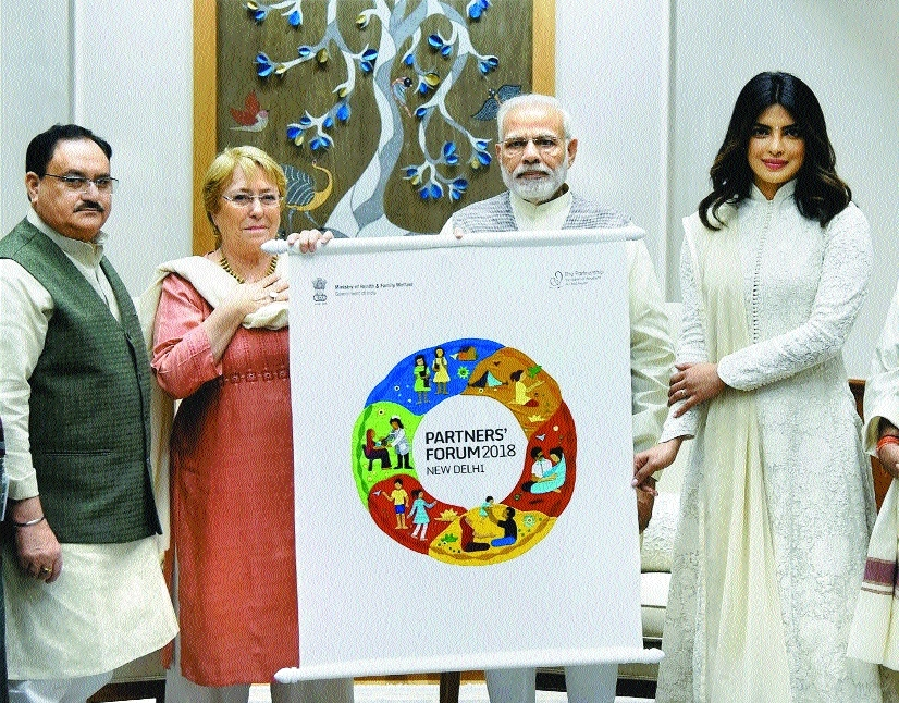 P M Narendra Modi being presented a logo for the 2018 Partners Forum by U H Minister J P Nadda and a member of PMNCH in the presence of  Bollywood actress Priyanka Chopra in New Delhi