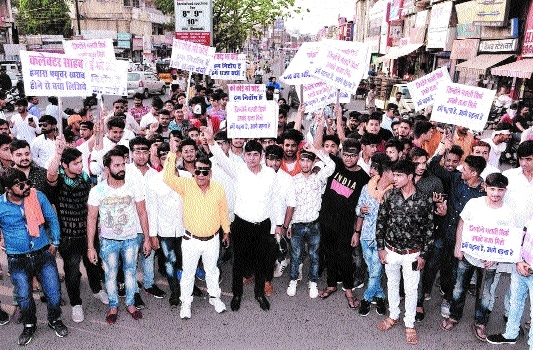 CBSE students carry out silent protest rally