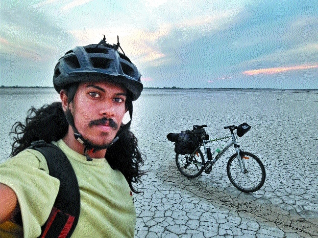 Cycling enthusiast peddling his way across country