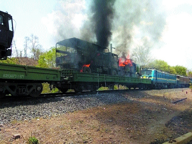 Four Army trucks gutted as goods train catches fire