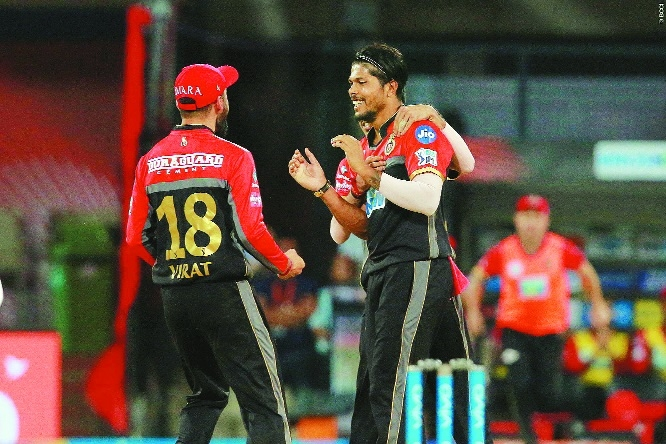 Dominant RCB thrash Kings XI by 10 wickets to live another day