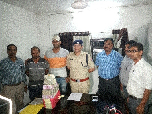 Man arrested with over 74 lakh cash, gold biscuits