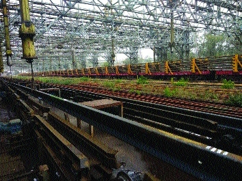 Electrical system of telfers modified for loading of long rails