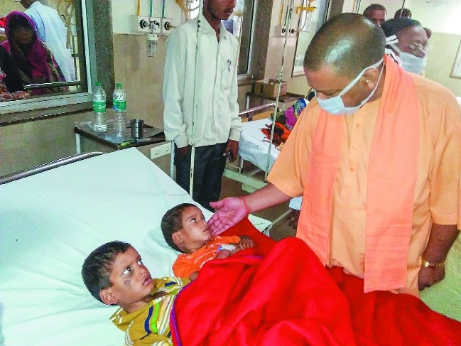 Adityanath meets dust storm affected families