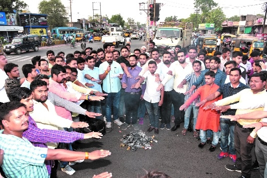 BJYM office-bearers burn tobacco products