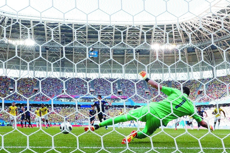 Japan sink 10-man Colombia in historic win