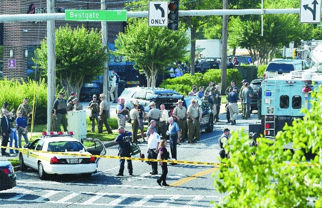 Upset with newspaper, US gunman kills five in newsroom shooting