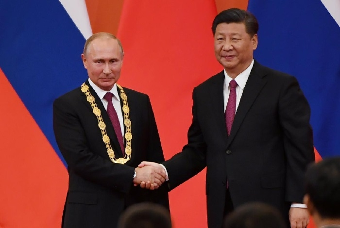 Xi awards China's first friendship medal to Putin