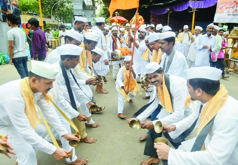 Devotees participate in a Dindi procession of Lord Vitthal on the occasion of Ashadi Ekadashi at a temple in Mumbai