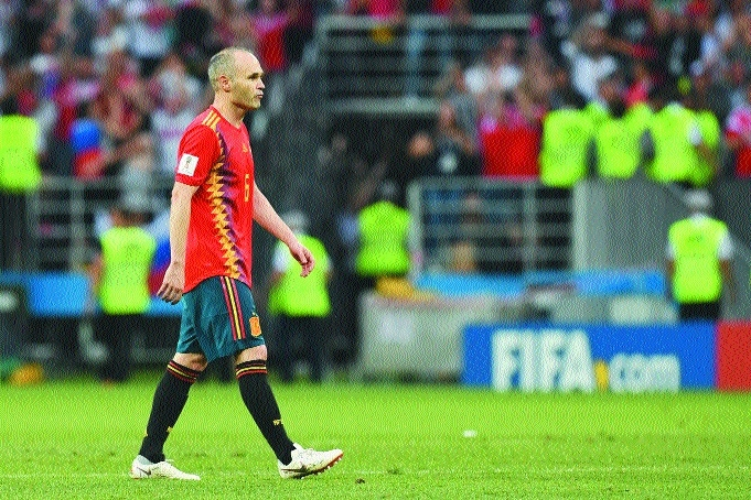 Iniesta retires from Spain after loss