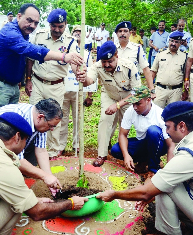 Police officials plant saplings at police line of Nehru Nagar