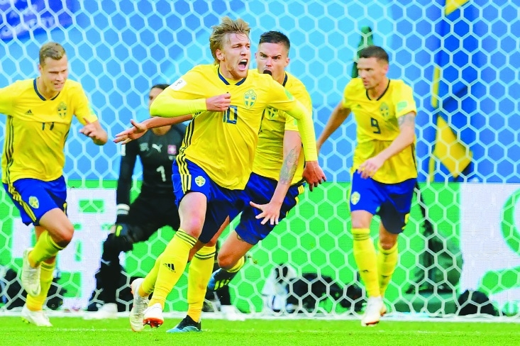 Swedes edge Swiss