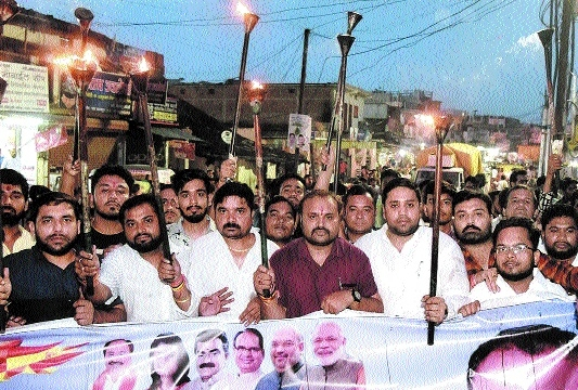 BJYM takes out torch rally against Bangladeshi infiltrators