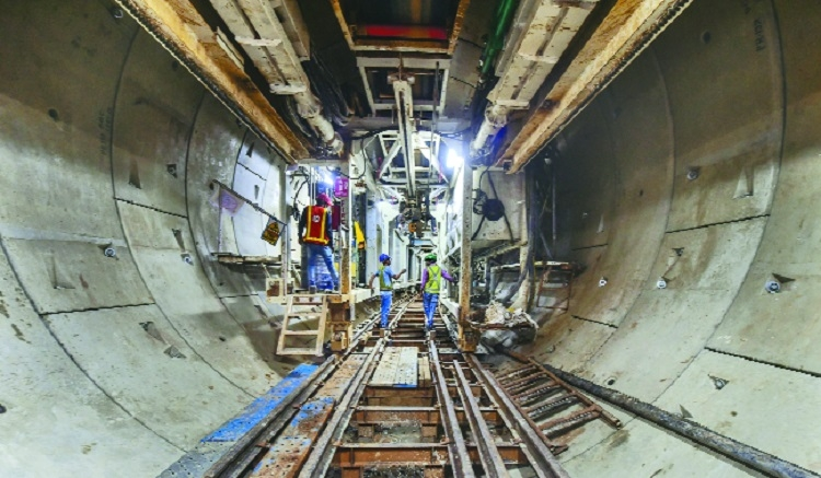 Ahmedabad Metro employees work at an under construction tunnel at Kalupur Ahmedabad on Wednesday