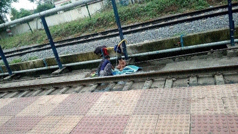 Woman with a baby spotted taking bath on railway track