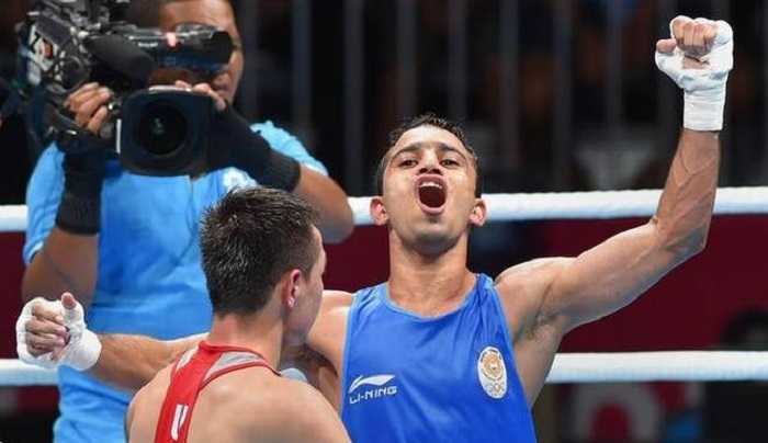Amit beats Olympic champ for gold