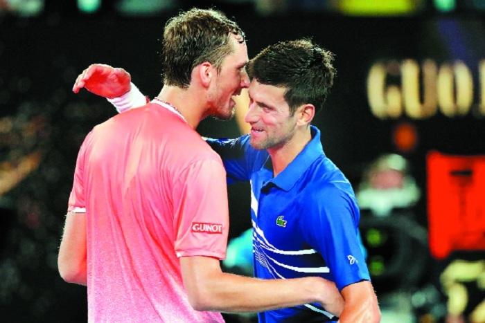 Djokovic gets grind past Medvedev into quarters